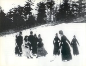 Isobel Stanley and other women playing hockey